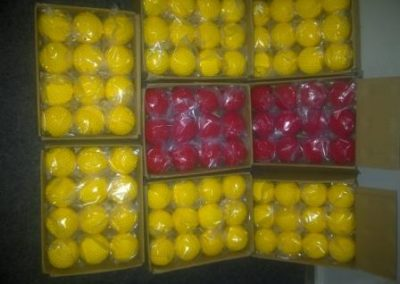 red and yellow dimple balls